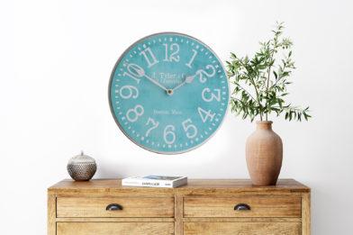 turquiose wall clock in room